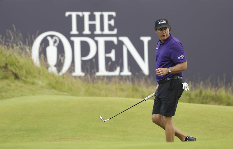 FILE - In this July 16, 2019, file photo, Phil Mickelson walks on the 18th green during a practice round ahead of the start of the British Open golf championships at Royal Portrush in Northern Ireland. Mickelson has decided to play the Saudi International next year, missing the Phoenix Open for the first time in 29 years. (AP Photo/Peter Morrison, File)