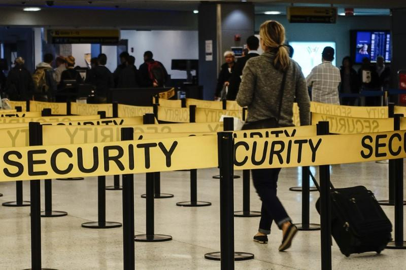 Passengers make their way in a security checkpoint at the International JFK airport in New York