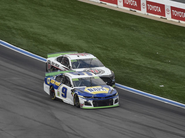 Chase Elliott (9) passes Kevin Harvick (4) for the lead and the win during a NASCAR Cup Series auto race at Charlotte Motor Speedway, Sunday, Sept. 29, 2019, in Concord, N.C. (AP Photo/Mike McCarn)