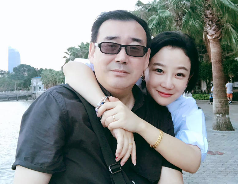 "In this 2017 photo provided by his family, Yang Hengjun, left, poses with his family member in Beijing. Australia's Foreign Minister Marise Payne said on Friday, July 19, 2019, her government was ""deeply disappointed"" that the Chinese-Australian writer was placed in criminal detention in Beijing six months after he was taken into custody at a Chinese airport. (Yang Family Photo via AP)"
