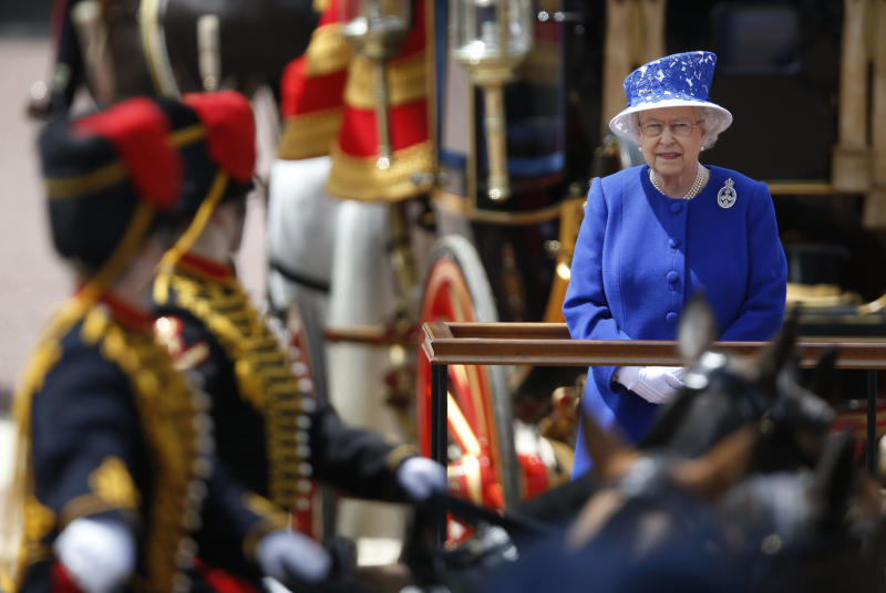 """Britain's Queen Elizabeth II as the Guards march past outside Buckingham Palace after the Trooping The Colour, at the Horse Guards Parade in London, Saturday, June 15, 2013. Queen Elizabeth II is celebrating her birthday with traditional pomp and circumstance _ but without her husband by her side. More than 1,000 soldiers, horses and musicians are taking part in the parade known as """"Trooping the Color,"""" an annual ceremony. (AP Photo/Sang Tan)"""