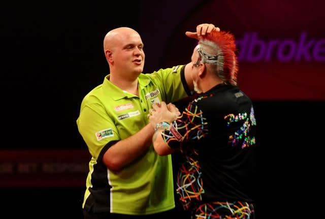 Michael Van Gerwen got the better of Peter Wright in their last PDC World Championship final showdown (Clive Gee/PA)
