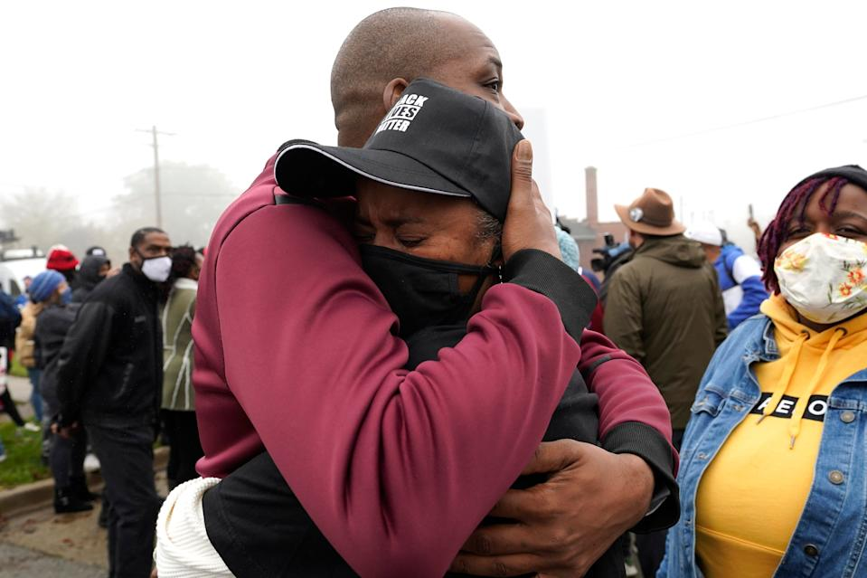 Marcellis Stinnette's grandmother Sherrellis Stinnette, right, cries as she hugs Rayon Edwards during protest rally for Marcellis Stinnette who killed by Waukegan Police Tuesday in Waukegan, Ill., Thursday, Oct. 22, 2020.