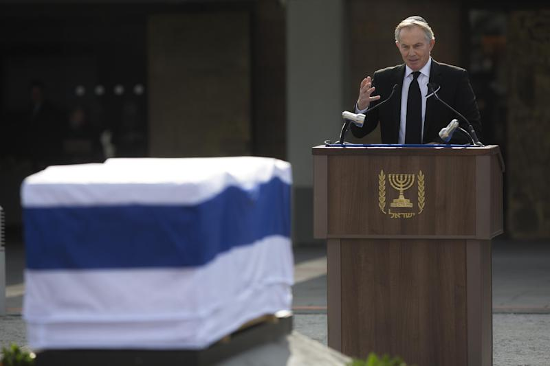 Former British Prime Minister and Mideast Envoy Tony Blair delivers a speech next to the coffin of late Israeli Prime Minister Ariel Sharon outside the Knesset, Israel's Parliament, in Jerusalem, Monday, Jan. 13, 2014. Israel is holding a state memorial ceremony for the former Prime Minister Ariel Sharon at the country's parliament building. Monday's official ceremony in the Knesset in Jerusalem will be followed by a private burial on the family's desert ranch in southern Israel. (AP Photo/Sebastian Scheiner)