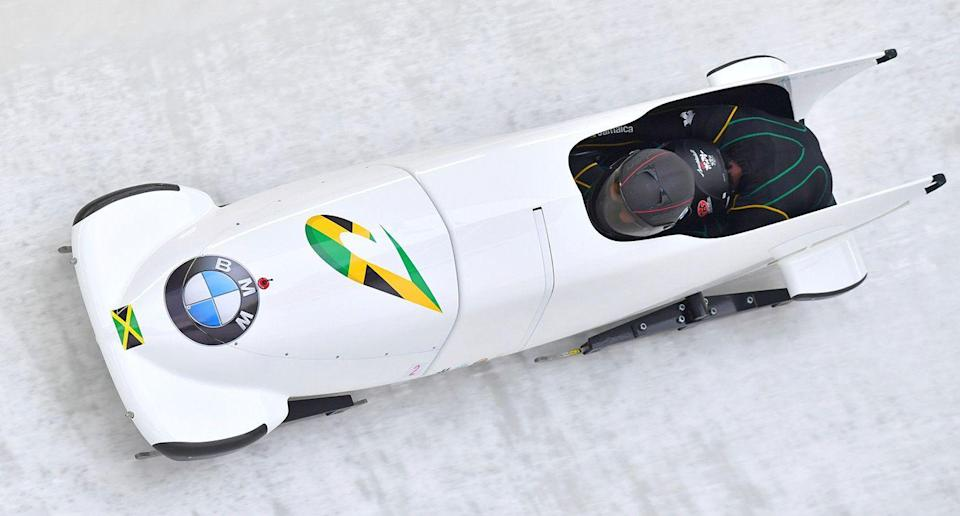 Nazmine Fenlator-Victorian and Carrie Russell of Jamaica speed down the track at a women's World Cup race. (AP Photo)