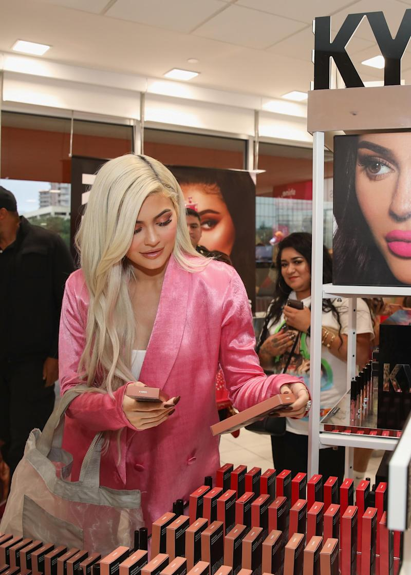 Kylie Jenner checking out her merchandise (Getty Images)