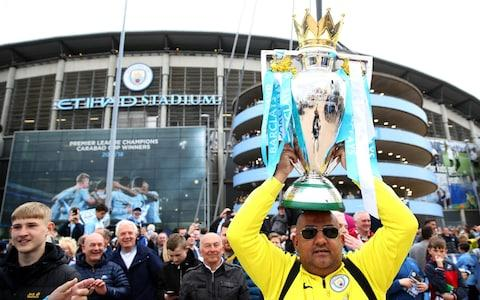 City fans with the trophy - Credit: getty images