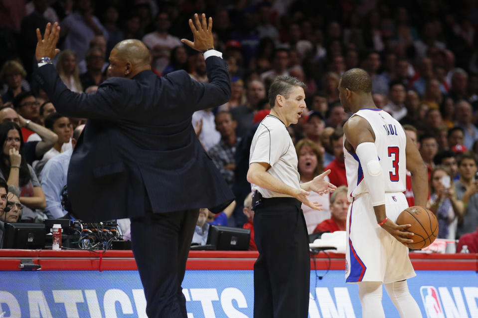 Chris Paul argues a backcourt violation with Scott Foster in 2015, and Doc Rivers has seen enough. (AP)
