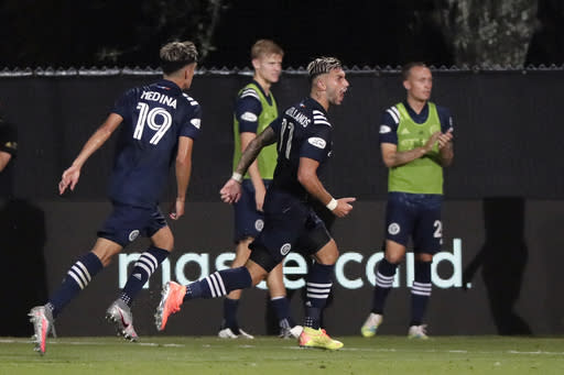 New York City FC midfielder Valentin Castellanos (11) celebrates his goal with forward Jesus Medina (19) during the second half of an MLS soccer match against Toronto FC, Sunday, July 26, 2020, in Kissimmee, Fla. (AP Photo/John Raoux)