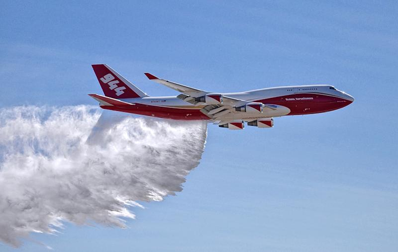 Debate over use of jumbo bomber as wildfires rage in West