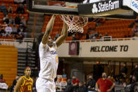 Oklahoma State forward Matthew-Alexander Moncrieffe (12) slam dunks the ball during the second half of the NCAA college basketball game against Iowa State in Stillwater, Okla., Tuesday, Feb. 16, 2021. (AP Photo/Mitch Alcala)
