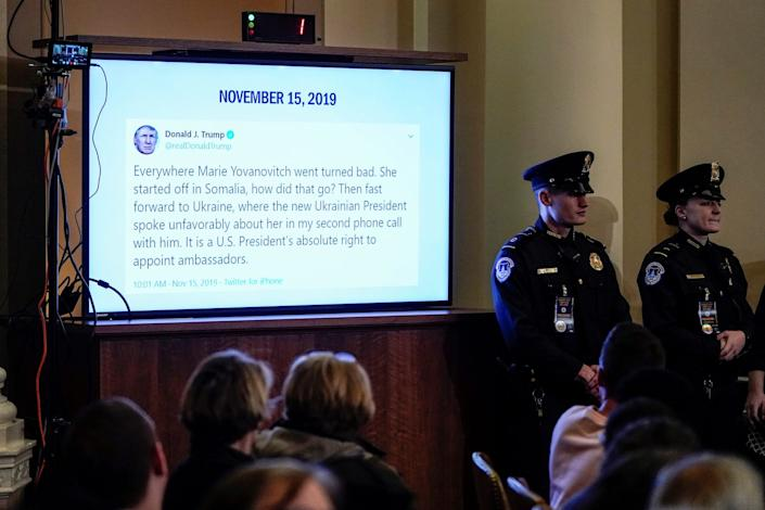A tweet from U.S. President Donald Trump about U.S. Ambassador to Ukraine Marie Yovanovitch is displayed during her testimony before the House Intelligence Committee in the Longworth House Office Building on Capitol Hill November 15, 2019 in Washington, DC.