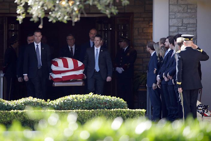Members of the U.S. Secret Service carry the casket with former President George H. W. Bush to a hearse at George H. Lewis Funeral Home after a family service, Monday, Dec. 3, 2018, in Houston. Monday, Dec. 3, 2018, in Houston.