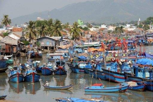 Fishing boats are anchored at the Vietnamese port of Nha Trang