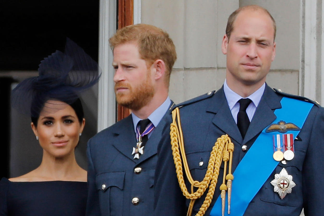 Image: Meghan, Prince Harry, and Prince William on the balcony of Buckingham Palace in 2018. (Tolga Akmen / AFP - Getty Images file)