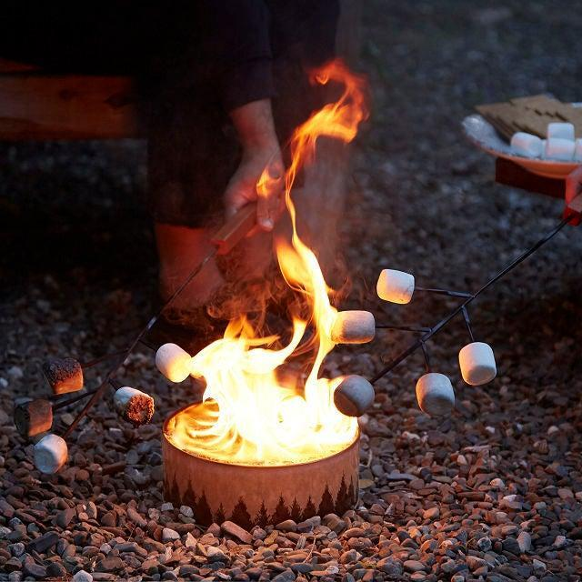 "<h3>Portable Campfire</h3> <br>Keep the smores and campfire songs on tap this summer no matter where you venture with this compact portable pit that's crafted from recycled materials. <br><br><strong>Radiate</strong> Portable Campfire, $, available at <a href=""https://go.skimresources.com/?id=30283X879131&url=https%3A%2F%2Fwww.uncommongoods.com%2Fproduct%2Fportable-campfire"" rel=""nofollow noopener"" target=""_blank"" data-ylk=""slk:Uncommon Goods"" class=""link rapid-noclick-resp"">Uncommon Goods</a><br>"