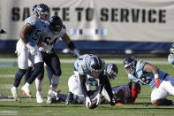 Tennessee Titans cornerback Desmond King (33) recovers a Chicago Bears fumble and returns it for a touchdown in the second half of an NFL football game Sunday, Nov. 8, 2020, in Nashville, Tenn. (AP Photo/Ben Margot)