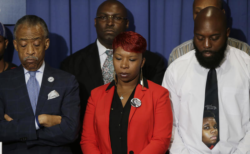 Michael Brown's parents at a press conference with civil rights activist Al Sharpton in September 2014 (Image: Reuters / Gary Cameron)