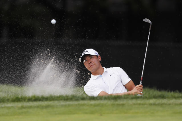 Xinjun Zhang of China hits onto the ninth green during the second round of the Rocket Mortgage Classic golf tournament, Friday, July 3, 2020, at the Detroit Golf Club in Detroit. (AP Photo/Carlos Osorio)