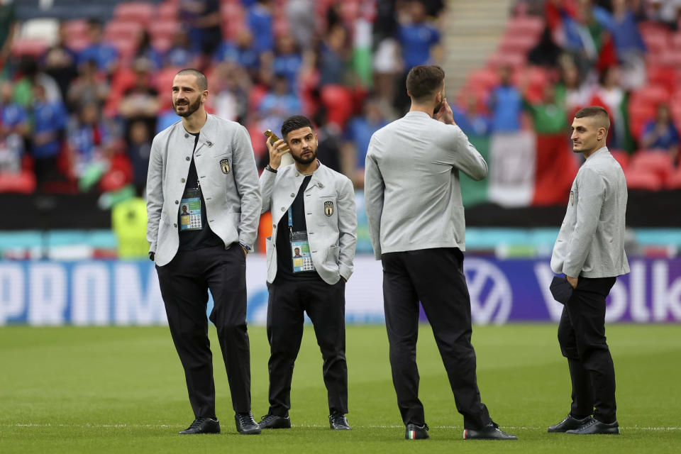 Italy players take a walk on the pitch before the Euro 2020 soccer championship final match between England and Italy at Wembley stadium in London, Sunday, July 11, 2021. (Carl Recine/Pool Photo via AP)