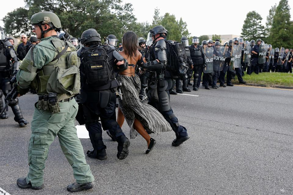 "Protestor Ieshia Evans is detained by law enforcement near the headquarters of the Baton Rouge Police Department in Baton Rouge, Louisiana, U.S. July 9, 2016. REUTERS/Jonathan Bachman SEARCH ""#BLACK LIVES MATTER"" FOR THIS STORY. SEARCH ""THE WIDER IMAGE"" FOR ALL STORIES."