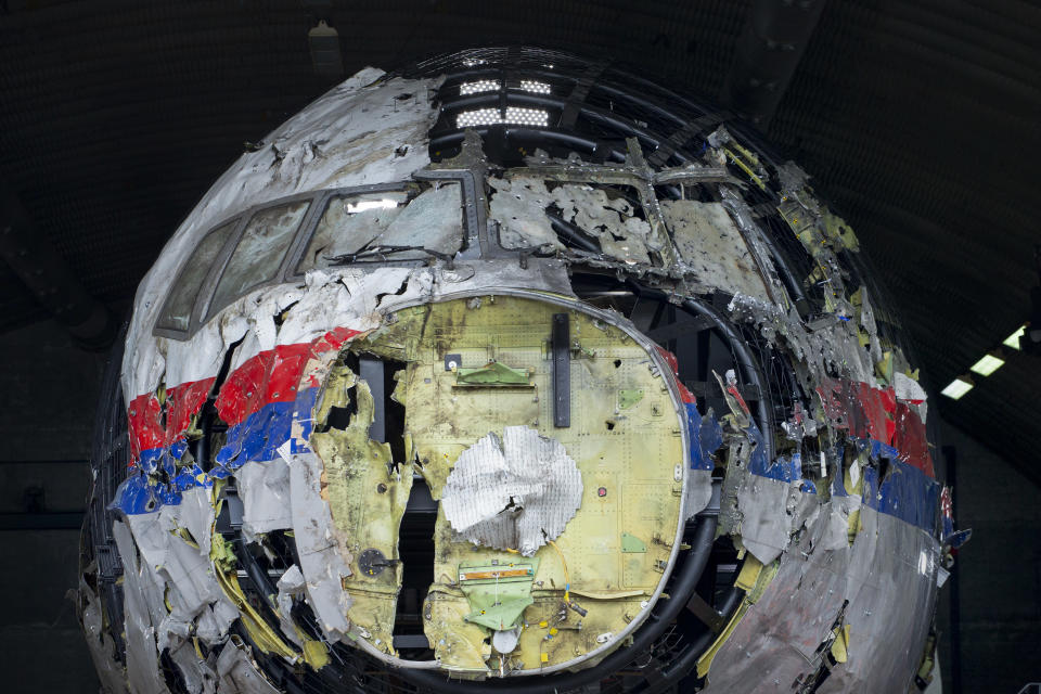 FILE- In this Wednesday, May 26, 2021, file photo the reconstructed wreckage of Malaysia Airlines Flight MH17, is shown at the Gilze-Rijen Airbase, southern Netherlands. The trial in absentia in a Dutch courtroom of three Russians and a Ukrainian charged in the downing of Malaysia Airlines flight MH17 in 2014 moves to the merits phase, when judges and lawyers begin assessing evidence. (AP Photo/Peter Dejong, File)