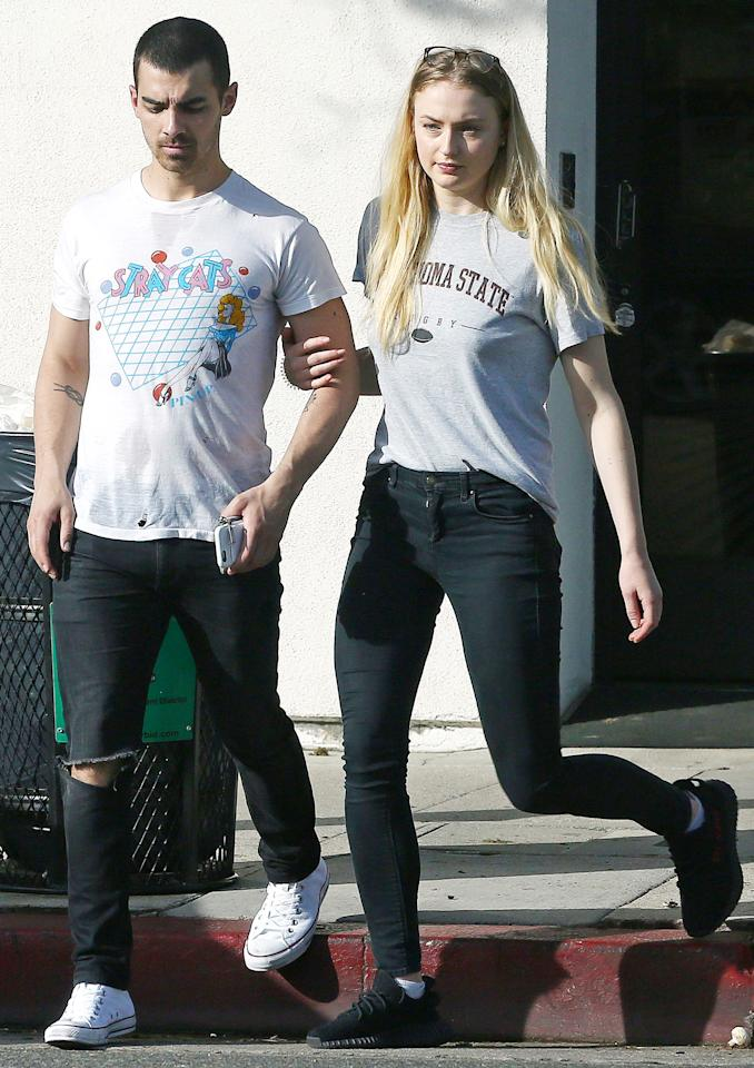 """<p>Color-coordinating is in their relationship DNA. Jonas and Turner stepped out for lunch in matching tees, black jeans, and sneakers—white <a rel=""""nofollow"""" href=""""http://shop.nordstrom.com/c/converse"""">Converse kicks</a> for him, black <a rel=""""nofollow"""" href=""""http://www.adidas.com/yeezy"""">Yeezys</a> for her. The couple who dresses together, stays together, right?</p>"""