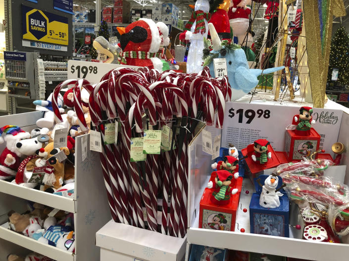 Candy canes and music boxes stand on a holiday display in a Lowe's store Friday, Oct. 2, 2020, in Northglenn, Colo. Add last-minute holiday shopping to the list of time-honored traditions being upended by the coronavirus pandemic. Retailers are kicking off the holiday season earlier than ever this year in hopes of avoiding big in-store crowds and shipping bottlenecks in November and December. (AP Photo/David Zalubowski)