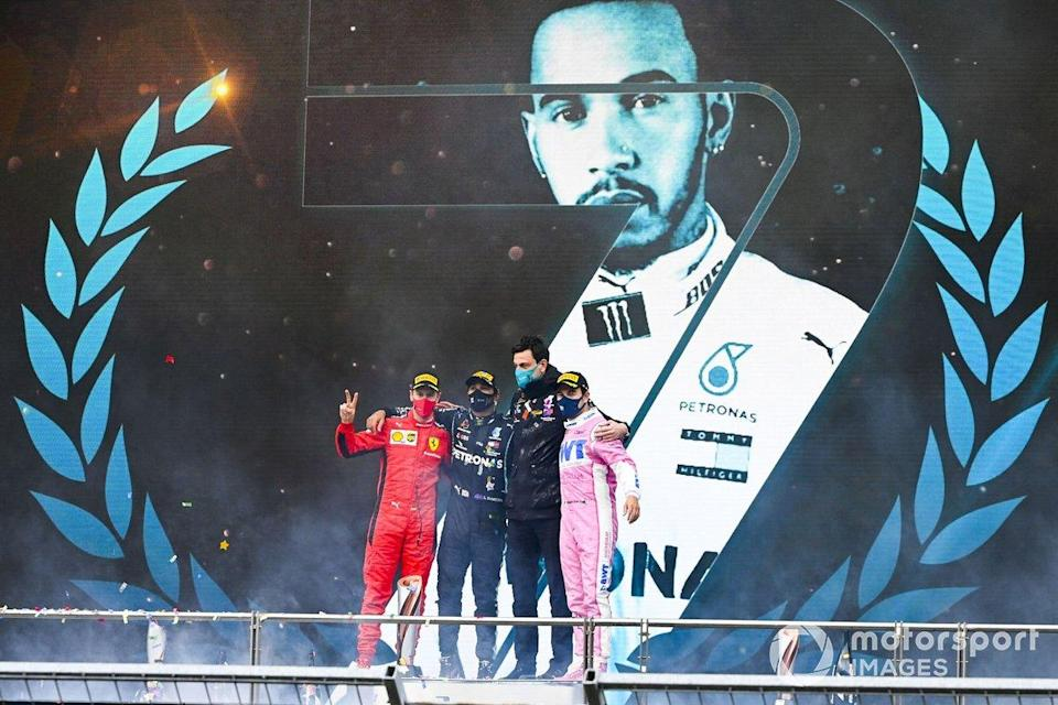 "Sebastian Vettel, Ferrari, Race Winner Lewis Hamilton, Mercedes-AMG F1, Toto Wolff, Executive Director (Business), Mercedes AMG and Sergio Perez, Racing Point celebrate on the podium<span class=""copyright"">Mark Sutton / Motorsport Images</span>"