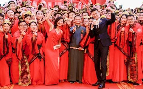 A total of 102 couples, each with at least one of the partners employed at the Alibaba Group, attend the Han Style group wedding - Credit: VCG via Getty Images