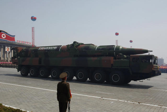 <p>A rocket is carried by a military vehicle during a military parade to celebrate the centenary of the birth of North Korea's founder Kim Il Sung in Pyongyang, April 15, 2012. (Bobby Yip/Reuters) </p>