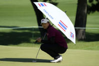 Patty Tavatanakit, of Thailand, stands under an umbrella on the first hole during the second round of the women's golf event at the 2020 Summer Olympics, Thursday, Aug. 5, 2021, at the Kasumigaseki Country Club in Kawagoe, Japan. (AP Photo/Andy Wong)