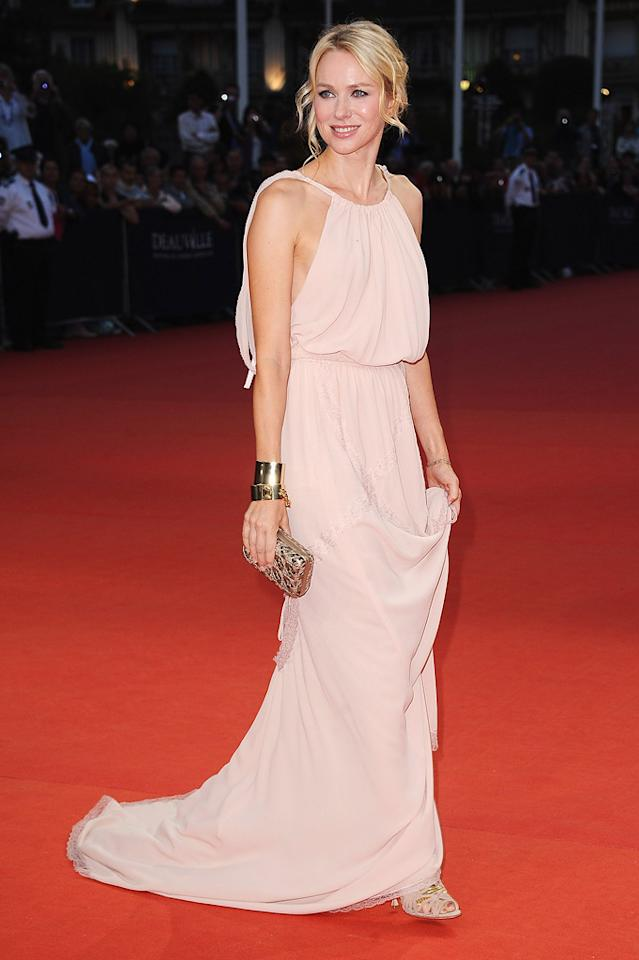 """Naomi Watts oozed elegance in a pale pink Nina Ricci gown upon arriving at the Deauville Film Festival premiere of """"Crazy, Stupid, Love."""" The blond bombshell's accessories included suede Brian Atwood """"Clayton"""" sandals, stacked gold cuffs, and a mirrored clutch. Francois Durand/<a href=""""http://www.gettyimages.com/"""" target=""""new"""">GettyImages.com</a> - September 9, 2011"""