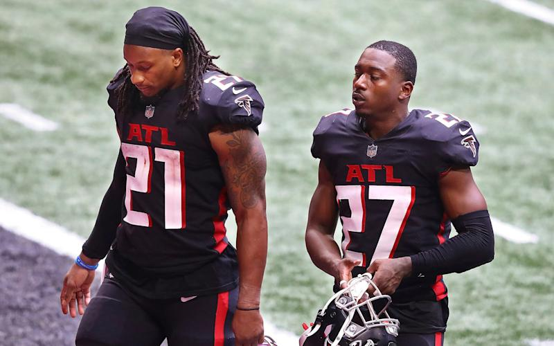 Atlanta Falcons running back Todd Gurley, left, and Damontae Kazee walk off the field after losing to the Chicago Bears in an NFL football game on Sunday, Sept. 27, 2020 in Atlanta. - AP