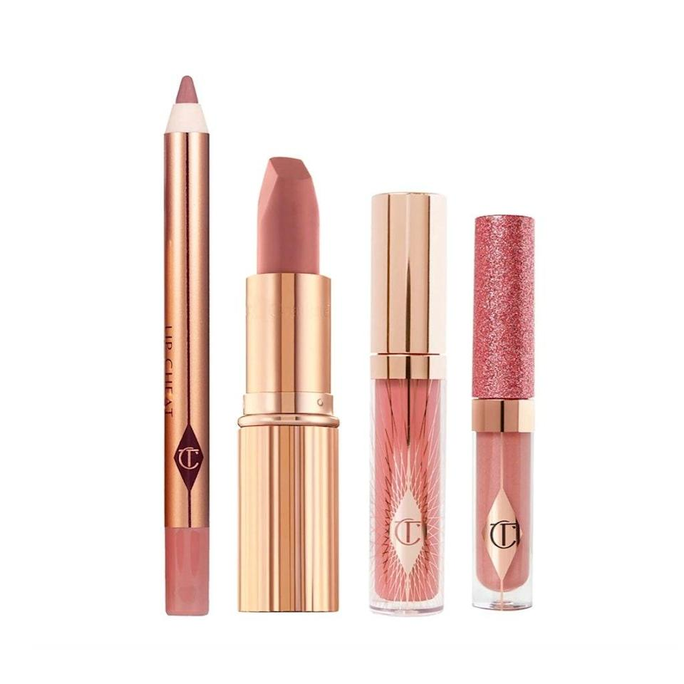 "Trust us, this lipstick has a <a href=""https://www.glamour.com/story/charlotte-tilbury-pillow-talk-lipstick-review?mbid=synd_yahoo_rss"" rel=""nofollow noopener"" target=""_blank"" data-ylk=""slk:cult following"" class=""link rapid-noclick-resp"">cult following</a> for a reason—and its matching counterparts will take a festive nude look to the next level. $45, Charlotte Tilbury. <a href=""https://shop-links.co/1723311762180306730"" rel=""nofollow noopener"" target=""_blank"" data-ylk=""slk:Get it now!"" class=""link rapid-noclick-resp"">Get it now!</a>"