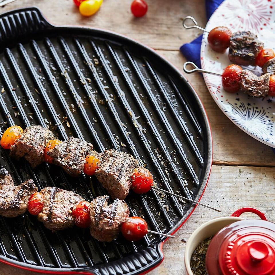 "To get grill marks, this grill pan from Le Creuset is made from cast iron and can be used on top of your stove. You can pick between artichoke, indigo and cerise colors. <a href=""https://fave.co/3nAZjfJ"" target=""_blank"" rel=""noopener noreferrer"">Originally $160, get it now for $100 at Sur La Table</a>."