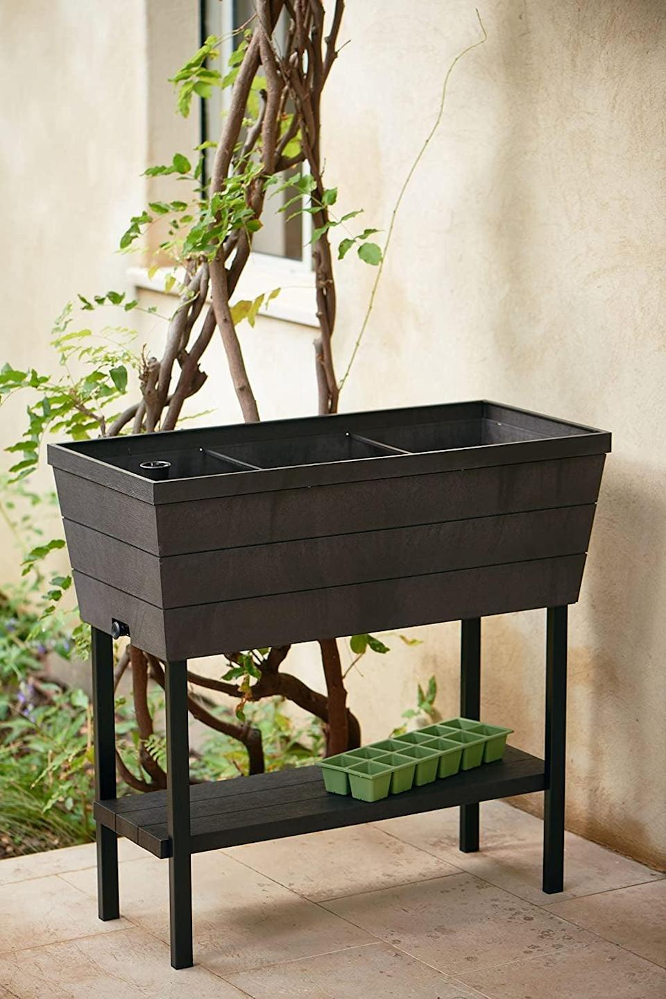 <p>If you want to start a garden and don't know where to start or just have limited space, you'll love this <span>Keter Urban Bloomer</span> ($89). It's a 12.7-gallon raised garden bed that has a self-watering planter box, and a drainage plug. It has an easy to read water gauge that indicates when plants need additional moisture, a full watering system that includes a reservoir to prevent root decay and over watering, and it's easy to assemble. It's perfect as an herb garden or balcony planter.</p>