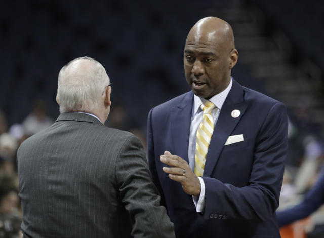 Wake Forest head coach Danny Manning, right, greets Miami head coach Jim Larranaga, left, before an NCAA college basketball game in the Atlantic Coast Conference tournament in Charlotte, N.C., Tuesday, March 12, 2019. (AP Photo/Nell Redmond)