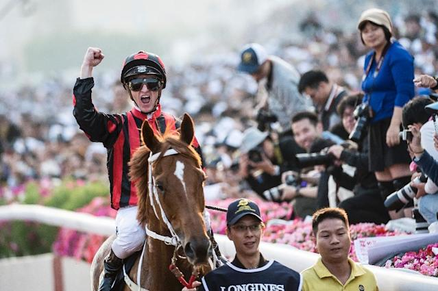 Australia's Zac Purton onboard 'Time Warp' clinches victory at the Hong Kong Cup (AFP Photo/ISAAC LAWRENCE)