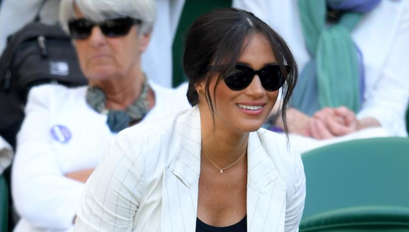 Meghan Markle attends day four of Wimbledon 2019 wearing a letter with her son Archie's initial 'A' [Photo: Getty]