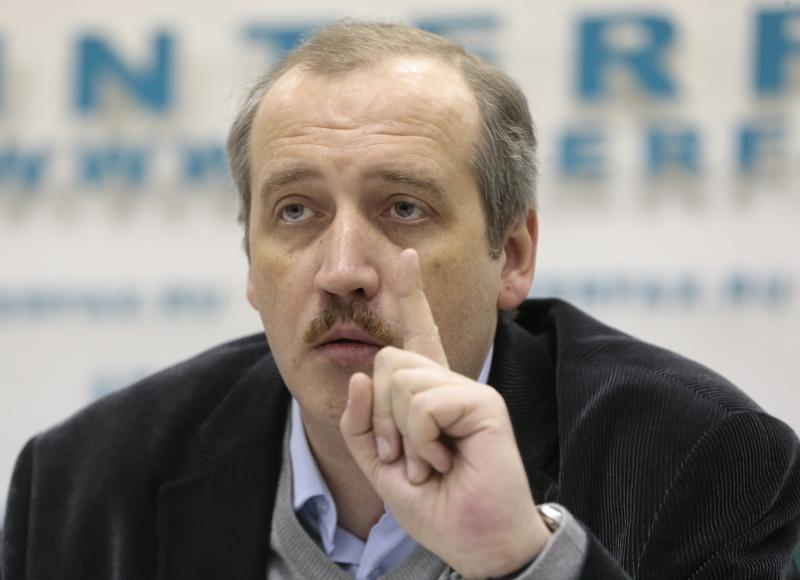 Sergei Sokolov, a deputy editor of Russia's Novaya Gazeta newspaper where Anna Politkovskaya worked before her 2006 murder, speaks during a news conference in Moscow, Russia, Tuesday, Dec. 11, 2012. The relatives of a slain Russian journalist are contesting a deal that was made between one of the accused in the case and the authorities investigating the case. While six individuals were originally charged for organizing and carrying out the 2006 murder of Anna Politkovskaya, a sharp critic of the Kremlin's policies in Chechnya, none of them are now sitting behind bars for the crime. (AP Photo/Mikhail Metzel)