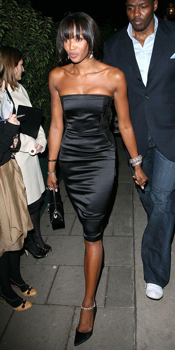<p>The below-the-knee length on Naomi Campbell's silk corset dress keeps the look sophisticated and classic. </p>