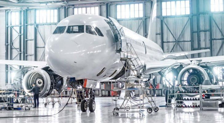 a private plane inside a hangar is prepared for a flight