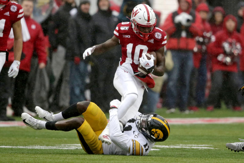 Nebraska wide receiver JD Spielman (10) is tackled by Iowa defensive back Michael Ojemudia (11) during the first half of an NCAA college football game in Lincoln, Neb., Friday, Nov. 29, 2019. (AP Photo/Nati Harnik)