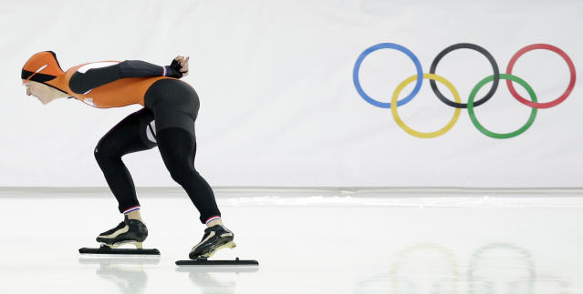 Ireen Wust of the Netherlands skates her way to gold in the women's 3,000-meter speedskating race at the Adler Arena Skating Center during the 2014 Winter Olympics, Sunday, Feb. 9, 2014, in Sochi, Russia. (AP Photo/Pavel Golovkin)