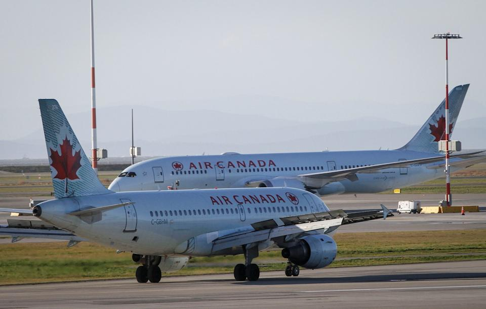 RICHMOND CANADA, Jan. 13, 2021 -- Air Canada aircrafts are seen on the runway of Vancouver International Airport in Richmond, British Columbia, Canada, Jan. 13, 2021. Air Canada announced on Wednesday that it is laying off about 1,700 employees due to official travel restrictions against the rampaging COVID-19 pandemic. (Photo by Liang Sen/Xinhua via Getty) (Xinhua/Liang Sen via Getty Images)