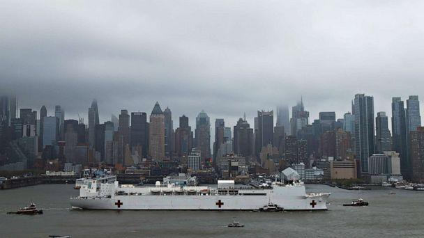 PHOTO: The U.S. Navy hospital ship USNS Comfort departs Pier 90 in Manhattan under thick fog to return to its home port of Norfolk, Va., after treating patients during the outbreak of the coronavirus (COVID-19) in New York City, April 30, 2020. (Mike Segar/Reuters)