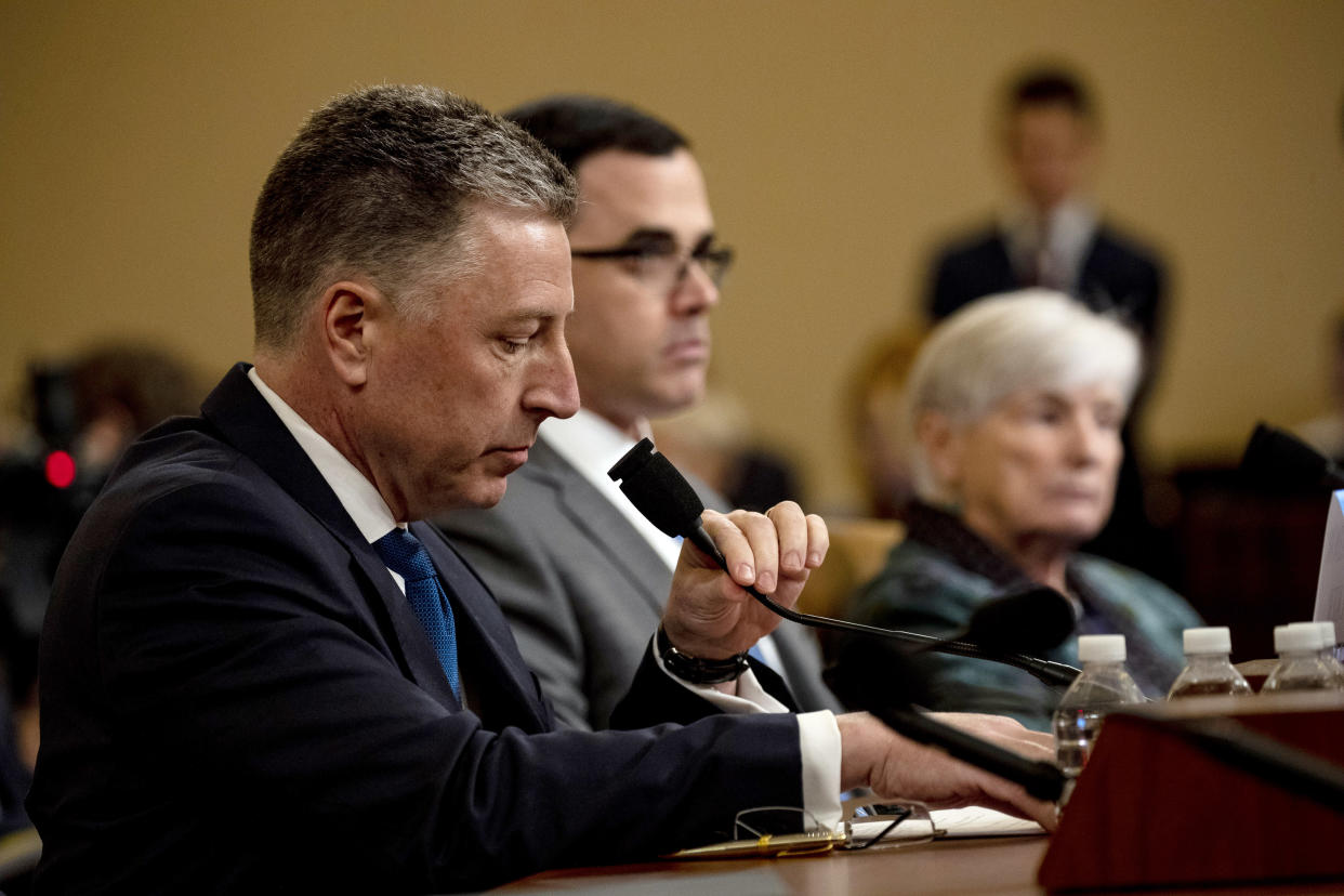 Kurt Volker, a former special envoy to Ukraine, adjusts his microphone as he and Timothy Morrison, the former head of Europe and Russia at the National Security Council, right, testify at an impeachment inquiry hearing in Washington on Tuesday, Nov. 19, 2019. (Anna Moneymaker/The New York Times)