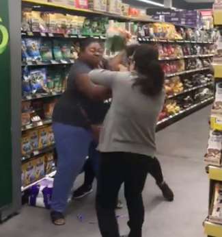 Shoppers were caught on video in a scrap of toilet paper inside Woolworths on the weekend. Source: Facebook