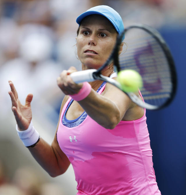 Varvara Lepchenko, of the United States, returns a shot against Serena Williams, of the United States, during the third round of the 2014 U.S. Open tennis tournament, Saturday, Aug. 30, 2014, in New York. (AP Photo/Darron Cummings)